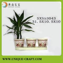 Three galvanized zinc round planters with tray