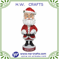 Holiday gift item resin Christmas Santa bobble head
