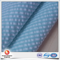 40polyester 60cotton yarn dyed light blue white striped seersucker fabric for woman