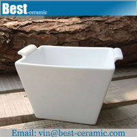 square white ceramic popcorn bowl with hand
