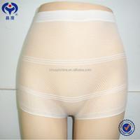 Transparent woman wearing panties disposable panties for spray tanning