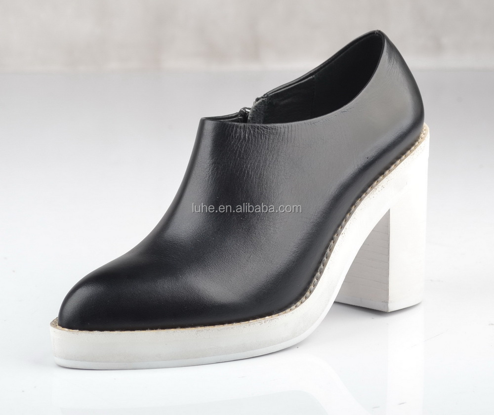 design black shoe with white chunky heel and