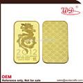2012 dragon top cantidad de material de cobre amarillo. 9999 pure gold clad barra del lingote