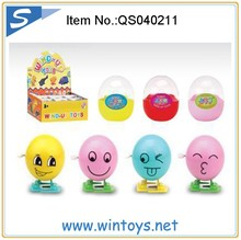 9pcs assorted smile face plastic wind up egg toy