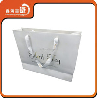 Branded retail custom made paper tote bag with ribbon rope