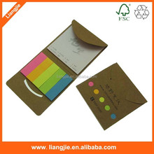 Funny smile faced combination of sticky notepads and adhesive flags