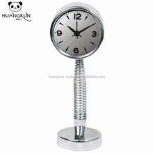 Spring type metal table clock