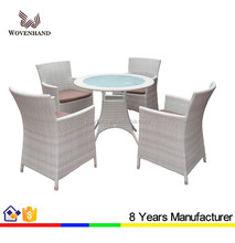 All weather used wicker Coffee Table Set with 4 arm chairs