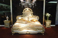 Palace royal style wooden double bed decorated with golden hand carving