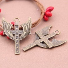 Zinc alloy jewelry accessories Tan wings cross accessories wholesale