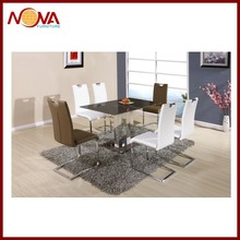 the tempered glass top with stainless steel legs dining table for sale