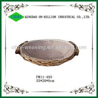 Woven round wicker tray with handle