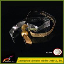 custom wristbands handcrafted for purple flower arrangements