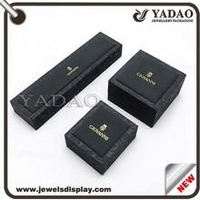 Custom black velvet packaging box with gold hot stamping logo and embossed pattern velvet box