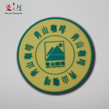 Low minimum silicone brand label for cup mat