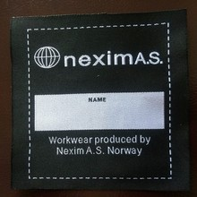 fire retardant woven label for fire retardant sheeting
