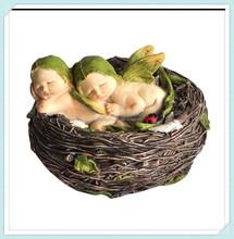 Miniature fairy garden and terrarium sleeping twin fairy babies in nest statue