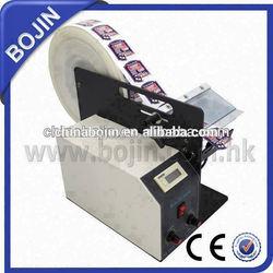 cosmetic adhesive label dispenser