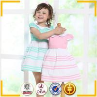 wholesale 100 % cotton material girls' dresses cap sleeve pink girls smocked dress