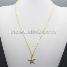 Gold tone pave mini star pendent necklace