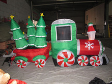 8 Foot Long Inflatable Santa Claus Driving Train On Candy Wheels Pulling Trees