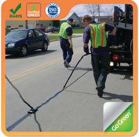Road surface sealant crack filler