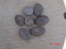 black beach pebbles beach rocks