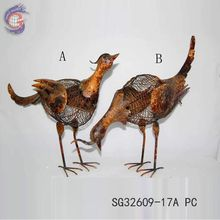 Antique garden decoration of rusty metal birds for decorating