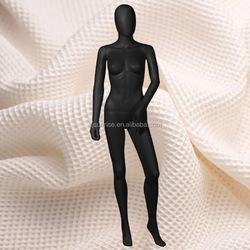 matt black female mannequin doll with egg head