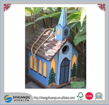 Cute decorated colorful wooden bird house