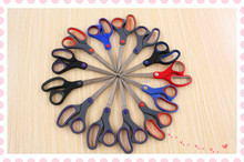 Stainless steel scissors with soft grip handle