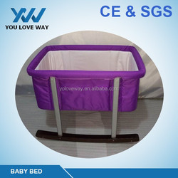 2016 hot sales comfortable material baby cradle/baby bed decoration with wooden feets