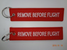 Remove before flight for airline lanyard/keychain
