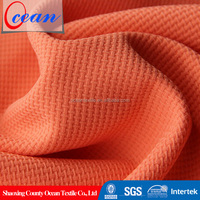 Woven FDY 4 Way Stretch Solid Orange 95 Polyester 5 Elastane Fabric