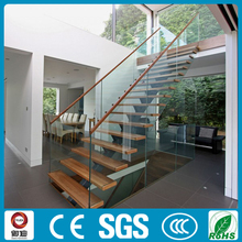 interior straight stringer staircase with wooden steps