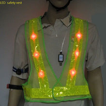 LED safety vest with reflective material