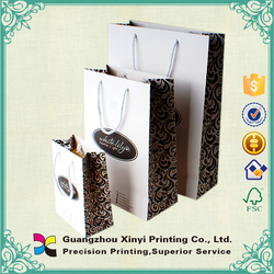 Low price popular glossy lamination white colour elegant newest advertising shopping paper bag in Guangdong