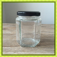 Clear hexagon glass storage jar with black metal lid,hermetic honey canister for promotion