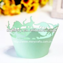 """laser cut """"dinosaur"""" decorative cupcake wrappers in various colors from Mery Crafts"""