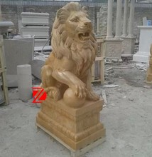 stone sitting lion with ball statue