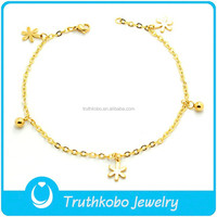 TKB-JB0194 Cute flowers and jingle bell charm jewelry 316L stainless steel children bracelet