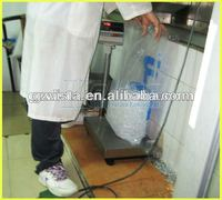 ice cube machine with plastic bagging system