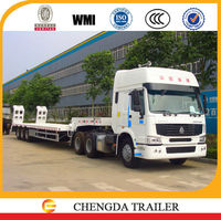 Cheap price SINOTRUK tractor and 80ton low bed trucks and trailers for sale