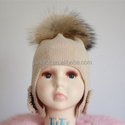 New arrival baby ear cap / warmer kids hat With Flower Ear Flaps and 15cm raccoon fur pompom cap