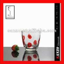 Clear tumbler glass cup with red color