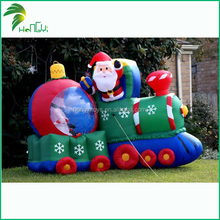 Animated Father Christmas With Gift From Inflatable Train
