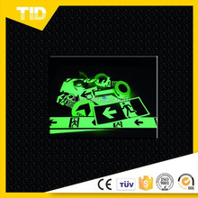 glow-in-the-dark vinyl (glows green), photo luminescent film
