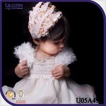 2014 banda elástico para bebé con pluma de nuevo modelo bandas para la cabeza al por mayor