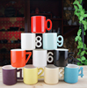 Haonai wholesale colored ceramic mug with number handle