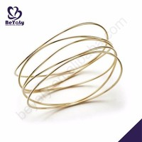Brilliant female handcrafted gold bangles pictures